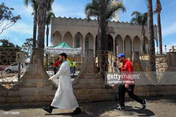 Members of the Muslim community arrive at Lakemba Mosque for a midday sermon on October 23 2020 in Sydney Australia Religious communities across New...