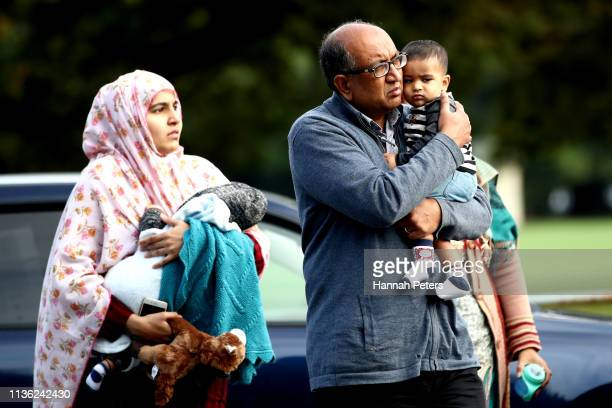 Members of the Muslim community arrive at the community centre on March 17 2019 in Christchurch New Zealand 50 people are confirmed dead with with 36...
