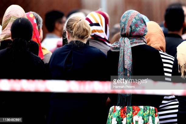 Members of the muslim community attend a blessing outside the Linwood Mosque on March 18 019 in Christchurch New Zealand 50 people are confirmed dead...