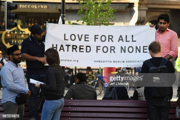 Members of the Muslim community attend a candlelit vigil to honour the victims of Monday evening's terror attack at Albert Square on May 23 2017 in...