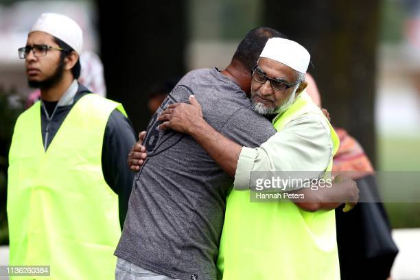 Members of the muslim community embrace outside the community centre on March 17, 2019 in Christchurch, New Zealand. 50 people are confirmed dead,...