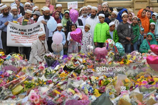 Members of the Muslim community gather at the floral tributes at St Ann's Square on May 24 2017 in Manchester EnglandAn explosion occurred at...