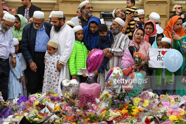 Members of the Muslim community gather at the floral tributes at St AnnÕs Square on May 24 2017 in Manchester EnglandAn explosion occurred at...