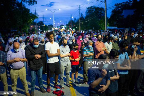 Members of the Muslim community gather to pray on Oxford Street on June 8, 2021 in London, Canada. A vigil was held earlier in the day, following a...