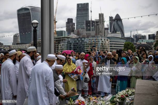 Members of the Muslim community lay flowers after attending a vigil for the victims of the London Bridge terror attacks in Potters Fields Park on...