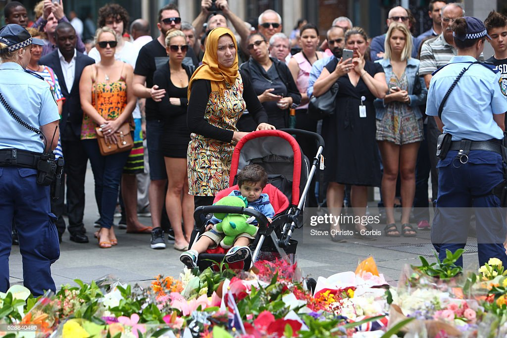 Australia siege at martin place in sydneys cbd pictures getty members of the muslim community lay flowers in a makeshift memorial at martin place after the mightylinksfo Images