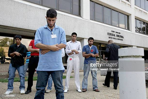 Members of the Muslim community pray before heading back into the federal courthouse in Raleigh North Carolina Tuesday August 4 2009 They were on...