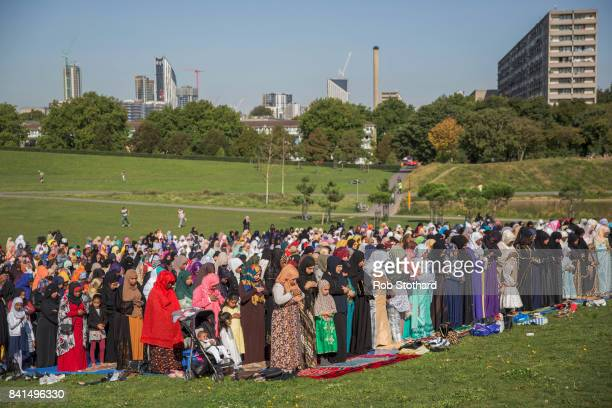 Members of the Muslim community pray in Burgess Park as part of the first day of Eid alAdha celebrations on September 1 2017 in London England...