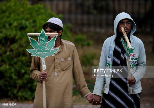 Members of the Muslim Institute hold banners during the commemoration of Kashmir Solidarity day in Pakistan on February 5 for each year in Islamabad...