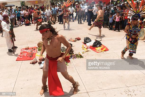 Members of the Nahua Pipil indigenous people participate in a ceremony commemorating the International Day of the World's Indigenous Peoples at El...