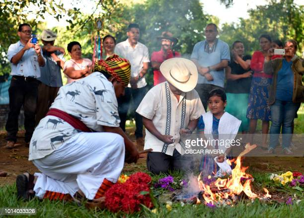 Members of the Nahuat Pipil indigenous people participate in a ceremony commemorating the International Day of the World's Indigenous Peoples at El...