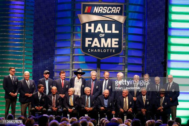 Members of the NASCAR Hall of Fame stand on stage during the 2019 NASCAR Hall of Fame Induction Ceremony at the Charlotte Convention Center on...
