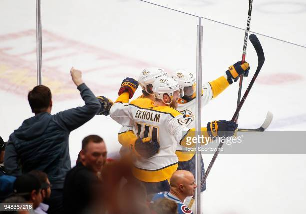Members of the Nashville Predators celebrate a first period goal by Predators left wing Filip Forsberg during a first round playoff game between the...