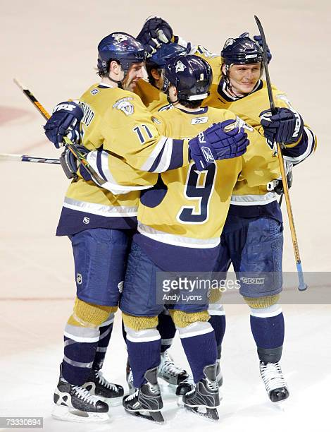 Members of the Nashville Predators celebrate a goal against the San Jose Sharks during NHL action February 14 2007 at Gaylord Entertainment Center in...