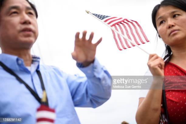 Members of the National Asian American Coalition speak to a reporter outside of the Greenville Convention Center on June 5, 2021 in Greenville, North...