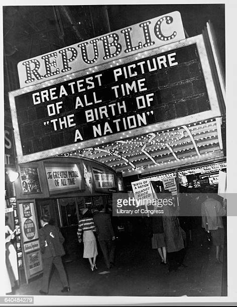 Members of the National Association for the Advancement of Colored People picket under the marquee of the Republic Movie Theatre against race...