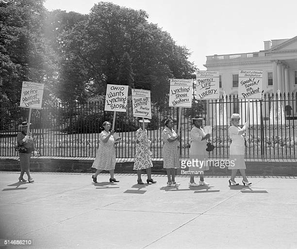 Members of the National Association of Colored Women picket the White House in protest of a quadruple lynching in Georgia