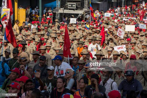 Members of the National Bolivarian Militia supporters of president Nicolás Maduro march during a demonstration on May 01 2019 in Caracas Venezuela...