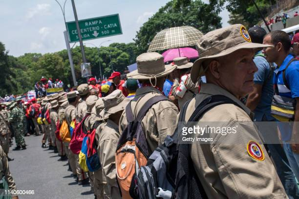 Members of the National Bolivarian Militia supporters of Venezuelan President Nicolás Maduro gather during a demonstration on May 1 2019 in Caracas...