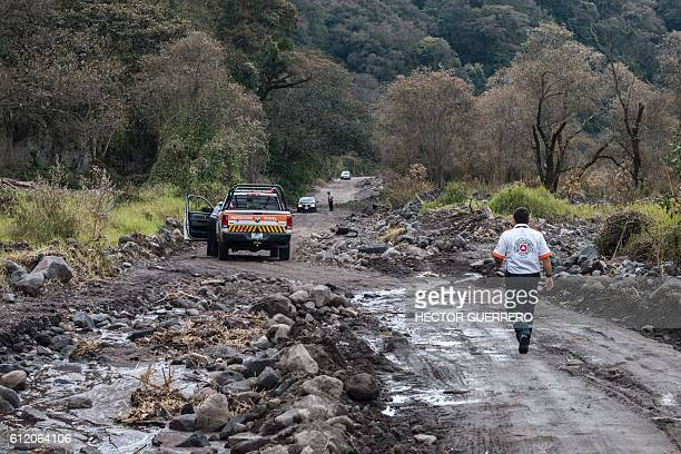 Members of the national civil protection patrol roads around the Volcano of Fire at La Becerrera community Colima State Mexico on October 2 2016...