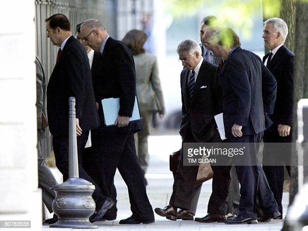 Members of the National Commission on Terrorist Attacks on the US walk in the West Executive entrance to the West Wing of the White House for their...
