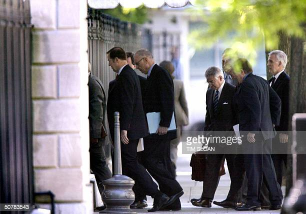 Members of the National Commission on Terrorist Attacks on the US file into the West Executive entrance to the West Wing of the White House for their...
