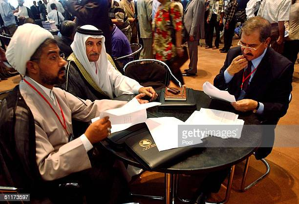 Members of the national conference Sheikh Khalid alShamari Dr Midhat Adulamir al Jiburi and Dr Midhat Abdul Nabi attend the opening of the threeday...
