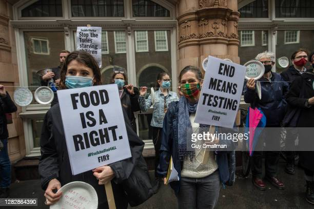 Members of the National Education Union and their supporters protest outside the Department for Education to demand free school meals for...