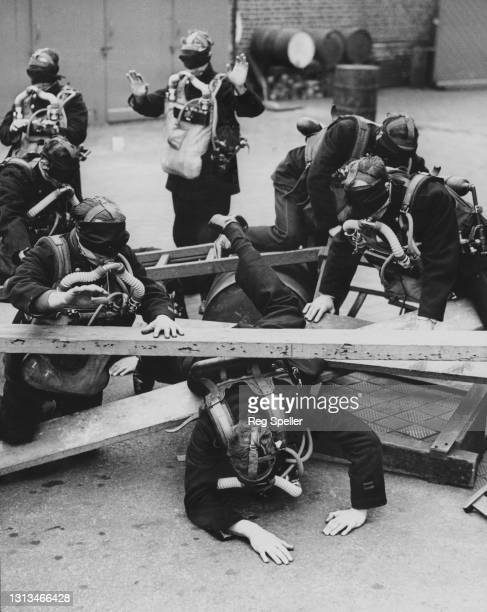 Members of the National Fire Service of the London Fire Brigade undergo a blindfold training exercise wearing oxygen breathing apparatus to simulate...