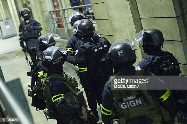 Members of the National Gendarmerie Intervention Group stand in position prior to a training exercise in the event of a terrorist attack in presence...