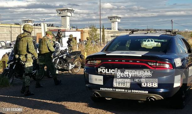 Members of the National Guard and of the Federal Police remain outside the Regional Center for Social Reinsertion after a riot in Zacatecas Mexico on...