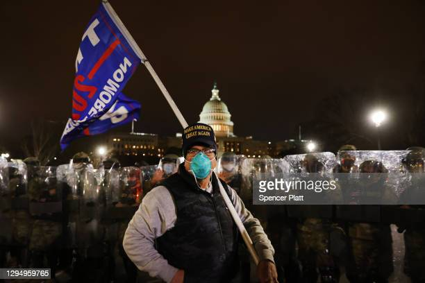 Members of the National Guard and the Washington D.C. Police keep a small group of demonstrators away from the U.S. Capitol on January 06, 2021 in...