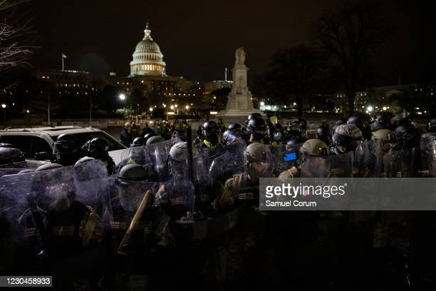Members of the National Guard and the Washington D.C. Police stand guard to keep demonstrators away from the U.S. Capitol on January 06, 2021 in...