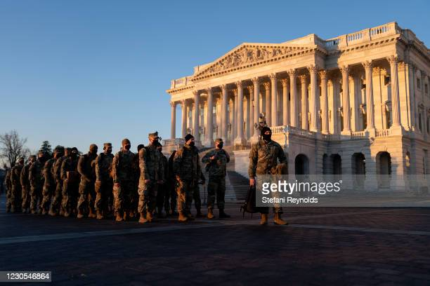 Members of the National Guard gather outside the U.S. Capitol on January 12, 2021 in Washington, DC. Today the House of Representatives plans to vote...