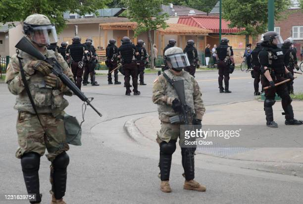 Members of the National Guard join police in holding a line on the fourth day of protests on May 29 2020 in Minneapolis Minnesota The National Guard...