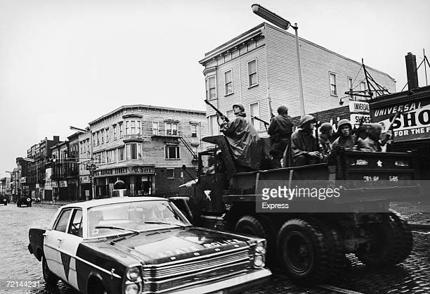 Members of the National Guard join the local police in searching for rooftop snipers during race rioting in Newark, New Jersey, 1967.