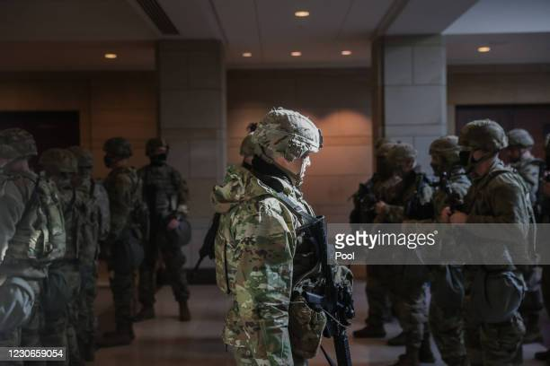 Members of the National Guard leave the U.S. Capitol Visitor Center after a security threat during a dress rehearsal ahead of the 59th Inaugural...