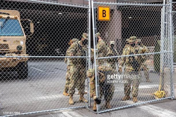Members of the National Guard lock the security gate outside the Hennepin County Government Center on March 9, 2021 in Minneapolis, Minnesota. - Jury...