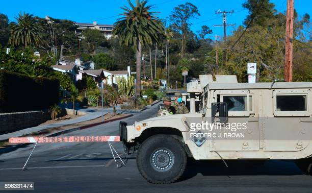 Members of the National Guard man a roadblock to evacuated homes in Santa Barbara California on December 20 amid concerns the return of winds may...