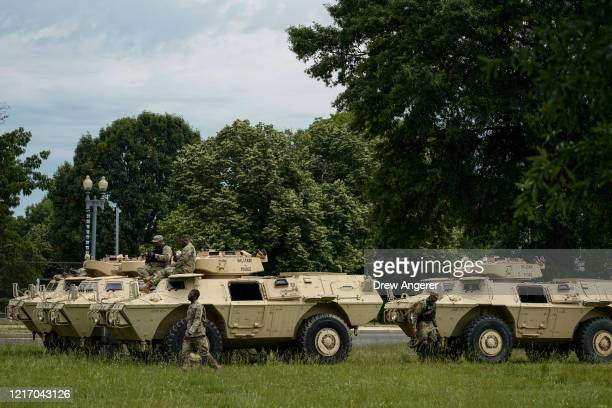 Members of the National Guard Military Police board armored personnel carriers at the Joint Force Headquarters of the DC National Guard on June 2...