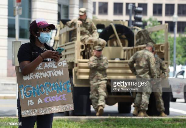Members of the National Guard monitor demonstrators protesting against police brutality and racism on June 6 2020 in Washington DC This is the 12th...