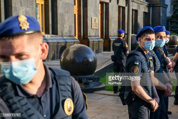 Members of the National Guard of Ukraine stand guard during an anti-presidential rally outside the President's office organised by opposition parties...