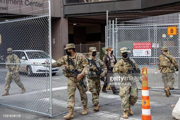Members of the National Guard open the security gate outside the Hennepin County Government Center on March 9, 2021 in Minneapolis, Minnesota. - Jury...