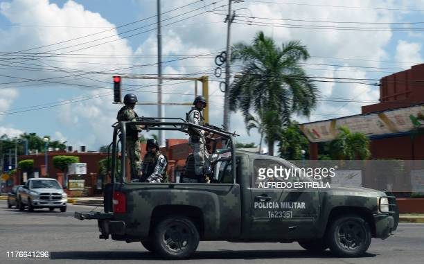 Members of the National Guard patrol a street in Culiacan Sinaloa state Mexico on October 18 2019 Mexico's president faced a firestorm of criticism...