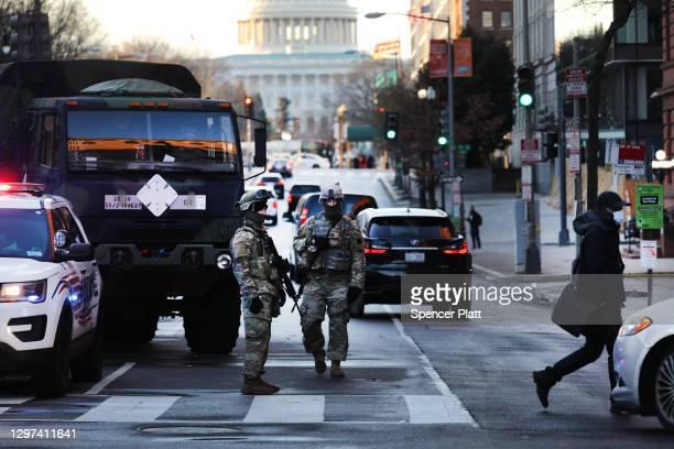Members of the National Guard patrol a street leading to the U.S. Capitol ahead of the inauguration of U.S. President-elect Joe Biden on January 20,...