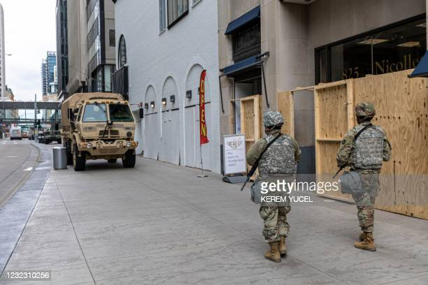 Members of the National Guard patrol downtown Minneapolis, Minnesota, on April 14,2021. - Minneapolis has been roiled by nights of violent protests...