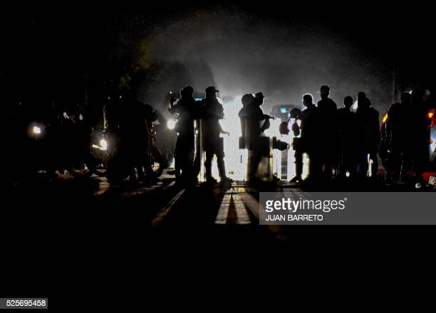 TOPSHOT Members of the National Guard patrol during the night a street in Maracaibo city on April 28 2016 The political tension shortages and now...