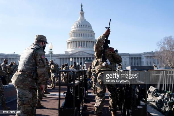Members of the National Guard prepare to distribute weapons outside the U.S. Capitol on January 14, 2021 in Washington, DC. Security has been...