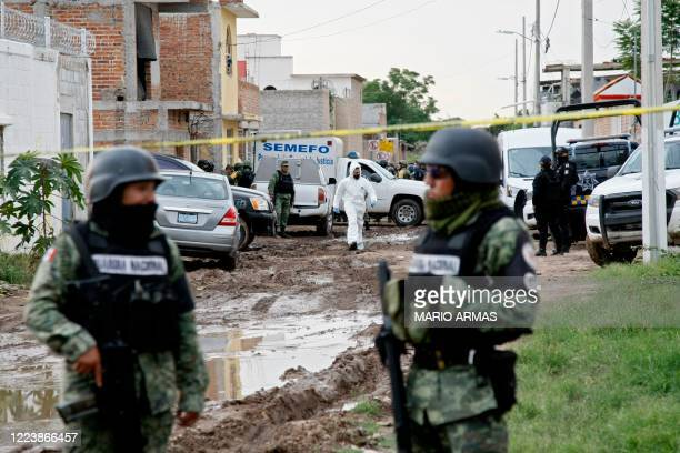 Members of the National Guard remain near the crime scene where 24 people were killed in Irapuato Guanajuato state Mexico on July 1 2020 An armed...