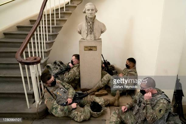 Members of the National Guard rest in the U.S. Capitol on January 13, 2021 in Washington, DC. Security has been increased throughout Washington...